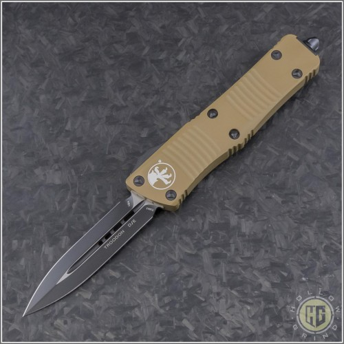 (#138-1TA) Microtech Tan Troodon D/E Black Plain - Front
