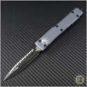 (#122-3GYCC) Microtech Gray Ultratech Black D/E Fully Serrated Contoured Chasis - Front